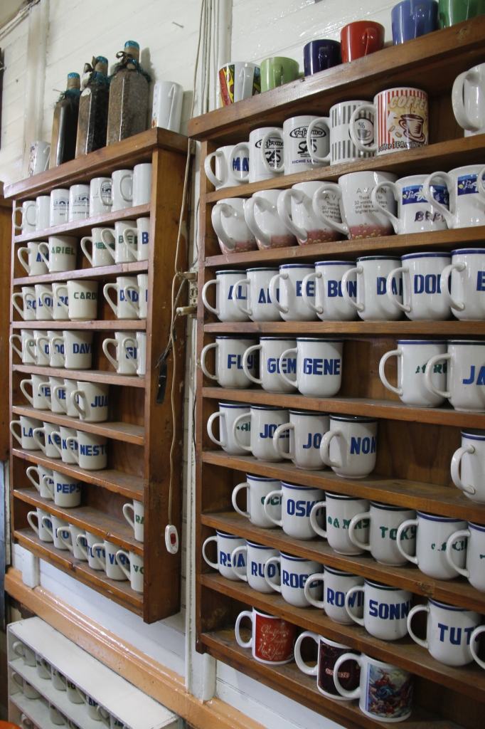 Madge coffee mugs engraved with their loyal customers names